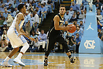 20 January 2016: Wake Forest's Mitchell Wilbekin (10) and North Carolina's Nate Britt (left). The University of North Carolina Tar Heels hosted the Wake Forest University Demon Deacons at the Dean E. Smith Center in Chapel Hill, North Carolina in a 2015-16 NCAA Division I Men's Basketball game. UNC won the game 83-68.