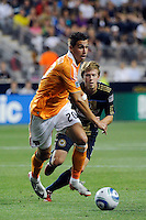 Geoff Cameron (20) of the Houston Dynamo is chased by Brian Carroll (7) of the Philadelphia Union. The Philadelphia Union and the Houston Dynamo played to a 1-1 tie during a Major League Soccer (MLS) match at PPL Park in Chester, PA, on August 6, 2011.