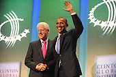 Former United States President Bill Clinton shakes hands with U.S. President Barack Obama following Obama's remarks at the Clinton Global Initiative gathering Wednesday, September 21, 2011 at the Sheraton New York Hotel and Towers in New York, New York..Credit: Aaron Showalter / Pool via CNP