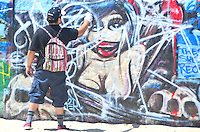 Graffiti  artist  who goes by the name Biffy paints at the Venice Art Wall on Saturday, June 23, 2012..