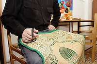 Man with is Chechen sejjadeh (pray carpet) and his Muslim rosary at the URiC Bielany refugee Centre in Poland..Four of his brother are missing (probably dead) from many years. He has been arrested for no reason and interrogated for 3 weeks accused to have connection to independentists he havent ever had. His wife has paid $2500 to the Russian administration to liberate him. He has escaped to Poland with his pregnant wife and children, 2 sons and 2 daughters, 7 month ago..-For security reason, the face of the adult asylum seeker have been evicted of the photography..-For security reason, the names of the adult asylum seeker have been change. .-Article 9 of the Act of 13 June 2003 on grating protection on the Polish territory (Journal of Laws, No 128, it. 1176) personal data of refugees are an object of particular protection..-Cases where publication of a picture or name of asylum seeker had dramatic consequences for this persons and is family back in Chechnya. .Please have safety of those people in mind. Thank you.