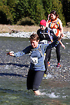 NELSON LAKES, NEW ZEALAND - APRIL 18:  Kellie Edwards crosses the Travers River during the 2015 Alpine Lodge Loop The Lake trail run at Lake Rotoiti on April 18 16, 2015 in Nelson, New Zealand. (Photo by Marc Palmano/Shuttersport Limited)