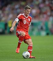 FUSSBALL       DFB POKAL 1. RUNDE        SAISON 2013/2014 in Osnabrueck BSV Schwarz-Weiss Rehden  - FC Bayern Muenchen  06.08.2013 Bastian Schweinsteiger (FC Bayern Muenchen) am Ball