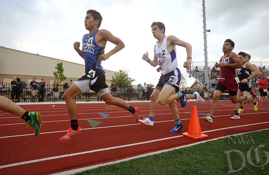 NWA Democrat-Gazette/BEN GOFF @NWABENGOFF<br /> Jessie Ramirez (4) of Rogers and Eli Johnson of Little Rock Catholic compete in the boys 1600 meter run Thursday, April 20, 2017, during the McDonald Relays at Fort Smith Southside. Ramirez won with a time of 4:24.98 minutes.
