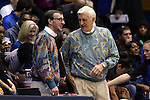 23 November 2014: Duke assistant coach Al Brown (right) with practice squad player Will Giles (left) and their sweaters. The Duke University Blue Devils hosted the Marquette University Golden Eagles at Cameron Indoor Stadium in Durham, North Carolina in a 2014-15 NCAA Division I Women's Basketball game. Duke won the game 83-51.