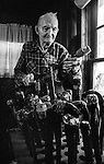"""December 1971:  Modesto, California—Dad Walkling— Gets his canes ready for sale.  I first met Orlando """"Dad"""" Walkling at his house in the airport district of Modesto just before his 104th birthday.  Walkling was born in Indian Territory January 2, 1868, near a town now called McAlester, Oklahoma.  His mother was Shawnee and his father, whom he didn't remember, was an Englishman named Orlando.  He later used the name Walkling instead of his Indian name of Skipocase.  On September 16, 1893, Skipocase O. Walkling, then 25 years old, was among thousands of settlers who rode into the Cherokee Strip Land Run of Oklahoma to make a free land claim.  Walkling told of how he rode into the 226-mile long """"Strip"""" to claim 160 acres.  """"There were thousands of men who waited at the line until noon that day.  The army gun was fired and chaos broke out. Every man carried a gun. There was no law, no sheriff, nothing.  People had to fight for their claim even though they were first.""""  Walkling made a claim, but later gave it up when he had a chance to farm a piece of land in Noble County, Oklahoma.  He cleared the land with six yoke of oxen and planted peach orchards.  He and his first wife ran a combination grocery store and hotel there.  He had nearly 1,000 trees and began a cannery to process the crops.  """"One day when the train came in a woman dressed like a Salvation Army woman handed me a bundle as I stood on the ramp, then she jumped back into the train.  I opened it and there was a pair of twins, a boy and a girl,"""" Walkling said.  He and his wife did not have children, so they adopted the twins legally and raised them.  He said they raised six others but did not adopt them.  He came to Modesto in 1944 at 76 years of age and went to work for a meat firm before he opened a poultry store.  After that store closed, he made bullwhips and wove rope for truckers at his home.  In 1968, Dad Walking, then 100 years old, visited Oklahoma for the 75th anniversary of the Running of"""