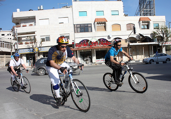 Palestinians compete during cycling race in the West Bank city of Hebron on March 14,2011.This event is the first of it kind on the local level and it was organized by the Palestinian Ministery of youth and sport as a preparing for the World Olympics in the United Kindom in 2012 .Photo by Najeh Hahlamoun
