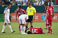 CARSON, CA – July 9, 2011: LA Galaxy midfielder Juninho checks on Chicago Fire midfielder Patrick Nyarko (14) during the match between LA Galaxy and Chicago Fire at the Home Depot Center in Carson, California. Final score LA Galaxy 2, Chicago Fire FC 1.