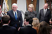 United States Vice President Mike Pence, from left, Betsy DeVos, U.S. secretary of education, and her husband Dick DeVos Jr. greet attendees after being sworn in in the Vice President's Ceremonial Office in Washington, D.C., U.S., on Tuesday, Feb. 7, 2017. DeVos squeaked through a history-making Senate confirmation vote to become U.S. education secretary, as Vice President Mike Pence broke a 50-50 tie and Republicans staved off last-minute defections that would have killed her nomination. <br /> Credit: Andrew Harrer / Pool via CNP