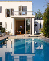 A swimming pool dominates the garden of this 1930s style house