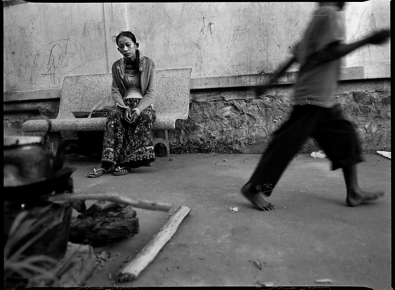 Siem Reap, Cambodia, December 2006..Kom Yeng, who shows signs of mental unbalance, lives in very precarious conditions among dozens of TB patients in insalubrious barracks at the back of the Provincial Hospital compound. TB is endemic in the region, fueled by poverty, malnutrition, inadequate hygiene and the spreading of HIV/AIDS. The percentage of drug-resistant TB strains is on a sharp rise due to inadequate treatments.