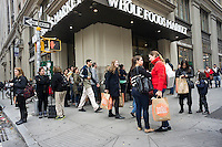 "Customers endure long lines because of Hurricane Sandy at Whole Foods supermarket in the Chelsea neighborhood of New York on Sunday, October 28, 2012. In advance of the arrival of Hurricane Sandy New York will down the subways at 7 PM on Sunday and evacuate low lying ""Zone A"" areas including Battery Park City. In addition the schools will be closed on Monday. (© Richard B. Levine)"