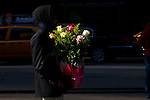 New York, United States. 14th February 2013 -- A man carries flowers for a present during celebrations of Saint Valentine's day in New York. Photo by Eduardo Munoz Alvarez / VIEWpress.