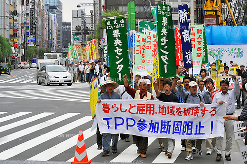 May 25th, 2013 : Tokyo, Japan - Demonstrators Marched against Trans-Pacific Strategic Economic Partnership Agreement, or TPP, at Ginza, Chuo, Tokyo, Japan on May 25, 2013. According to a demonstration authority, there were more than 2,000 people showed up from all over the nation. (Photo by Koichiro Suzuki/AFLO)