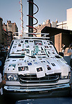 A news media van is covered in 'Missing' posters after the September 11, 2001 attacks in NYC.