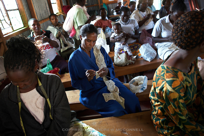 """The Totoknits group create handmade crochet items from their base at Karinde Anglican Church, in the Dagoretti area of Nairobi, Kenya, in Wednesday, Jan. 14, 2009. The Totoknits group consists of 150 women who produce some of the crochet hand-bags, cases and scarfs for MAX&Co. The products are part of the company's """"ethical fashion"""" range in Africa which is designed to reduce extreme poverty and empower women. The limited edition collection consists of one-of-a-kind handmade accessories such as shoulder-bags, bracelets, key-rings, belts and scarfs."""