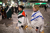 Members of a 'clique' that called for unity and peace in the world, stand watching as other participants walk by on the last night of Fasnacht, the Carnival of Basel in Switzerland. Feb. 26, 2015.