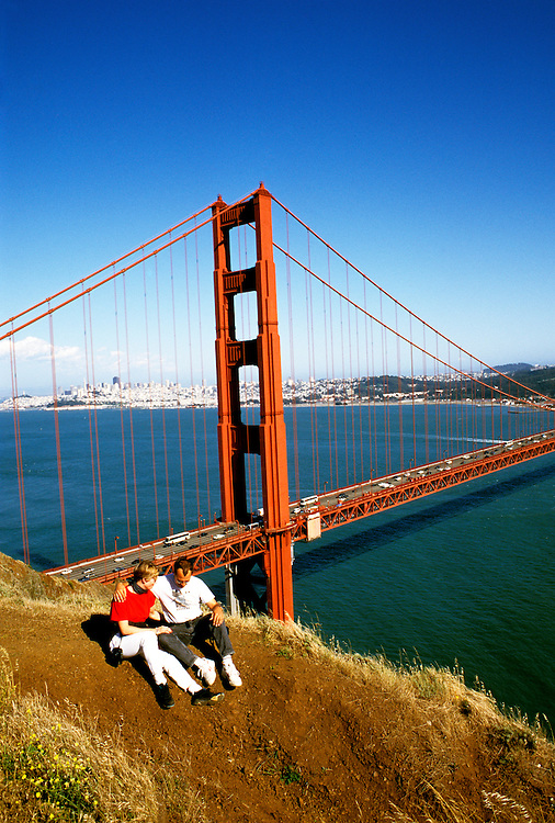 California: Marin County.  Couple on north side of Golden Gate Bridge.  Model Released..Photo copyright Lee Foster, 510/549-2202, lee@fostertravel.com, www.fostertravel.com..Photo # camari101