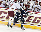 Travis Jeke (BC - 8), Grayson Downing (UNH - 28) - The Boston College Eagles and University of New Hampshire Wildcats tied 4-4 on Sunday, February 17, 2013, at Kelley Rink in Conte Forum in Chestnut Hill, Massachusetts.