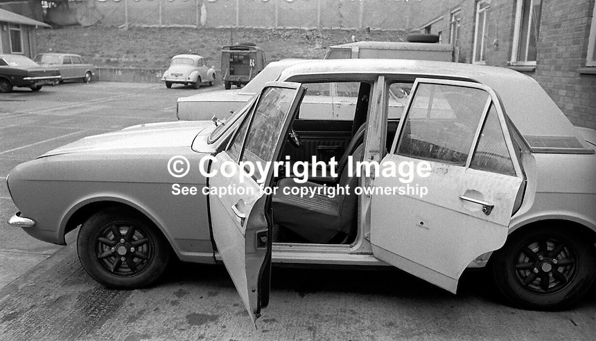 The car in which Anthony McDowell, schoolboy, 12 years, from Ardoyne area, Belfast, N Ireland, was travelling in when he died in crossfire during a Provisional IRA gun attack on British soldiers. Who actually  killed him in the incident on 19th April 1973 remains a mystery.  197304190208b<br /> <br /> Copyright Image from Victor Patterson, 54 Dorchester Park, Belfast, United Kingdom, UK.  Tel: +44 28 90661296; Mobile: +44 7802 353836; Voicemail: +44 20 88167153;  Email1: victorpatterson@me.com; Email2: victor@victorpatterson.com<br /> <br /> For my Terms and Conditions of Use go to http://www.victorpatterson.com/Terms_%26_Conditions.html