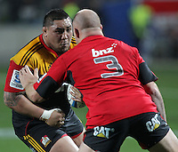 Chiefs' Ben Tameifuna is challenged by Crusaders' Ben Franks in the semi-final Super Rugby match, Waikato Stadium, Hamilton, New Zealand, Friday, July 27, 2012.  Credit:SNPA / David Rowland