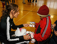Lolo Jones after signing autographs had give aways for the kids at Tobin Community Center on Friday, February 22, 2008. Photo by Errol Anderson,The Sporting Image.
