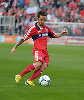 Chicago midfielder Daniel Paladini (11) crosses the ball.  The Chicago Fire defeated the New York Red Bulls 3-1 at Toyota Park in Bridgeview, IL on April 7, 2013.