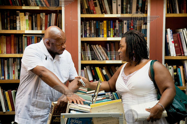 A couple in discussion at the antiquarian and second hand book sellers, the Brattle Book Shop.