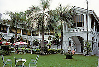 Singapore: Raffles Hotel Court. Hotel originally designed by Regent Alfred John Bidwell , 1899. Colonial style. Renovated several times. Photo '82.