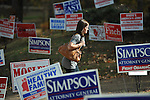 Meg Barefoot walks past campaign signs to vote at the polls at the Chamber of Commerce in Oxford, Miss. on Tuesday, November 8, 2011. Mississippians go to the polls today for state and local elections, as well as referendums including the so-called Personhood Amendment.