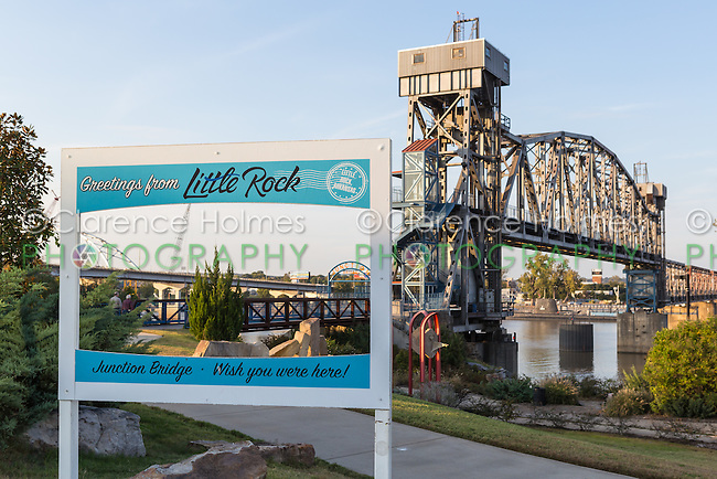 "A sign with ""Greeting from Little Rock"" on the path to the Junction Bridge in Little Rock, Arkansas."