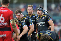 Dominic Day of Bath Rugby rallies his fellow forwards at a scrum. European Rugby Champions Cup match, between Bath Rugby and RC Toulon on January 23, 2016 at the Recreation Ground in Bath, England. Photo by: Patrick Khachfe / Onside Images