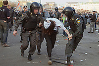 Moscow, Russia, 06/05/2012..Police arrest a protestor wearing a V For Vendetta mask at opposition demonstration against Russian Presidential election results on the eve of Vladimir Putins inauguration as President.