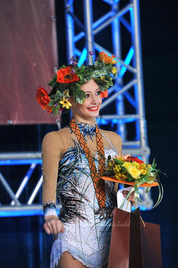 "YANA LUKONINA of Russia celebrates with headdress crown for  winning bronze in All Around at 2011 World Cup Kiev, ""Deriugina Cup"" in Kiev, Ukraine on May 7, 2011."