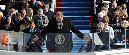 Washington, DC - January 20, 2009 -- Pastor Rick Warren (C) gives the invocation as President-elect Barack Obama and President George W. Bush bow there heads during the 56th Presidential Inauguration ceremony for Barack Obama as the 44th President of the United States in Washington, DC, USA 20 January 2009.  Obama defeated Republican candidate John McCain on Election Day 04 November 2008 to become the next U.S. President..Credit: Pat Benic - Pool via CNP
