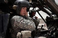 Captain Fine, US Army pilot from Charlie Company, Sixth Battalion, 101st Aviation Regiment prepares for takeoff on a medevac helicopter mission near Kandahar.