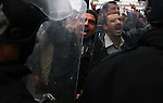 Protesters are contained by riot police, in downtown Tunis, Tunisia, Jan. 18, 2011. The Tunisian police and army struggled to maintain order in the capital, as thousands of protesters once again filled the streets.