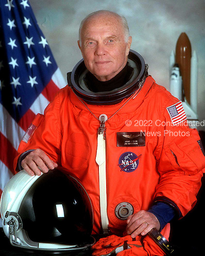 Official NASA portrait of United States Senator John H. Glenn Jr. (Democrat of Ohio), payload specialist for STS-95, taken in Houston, Texas on June 19, 1998. Glenn is wearing the orange, partial pressure launch and entry suit..Credit: NASA via CNP