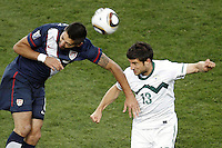 Carlos Bocanegra (L) of USA and Bojan Jokic (R) of Slovenia