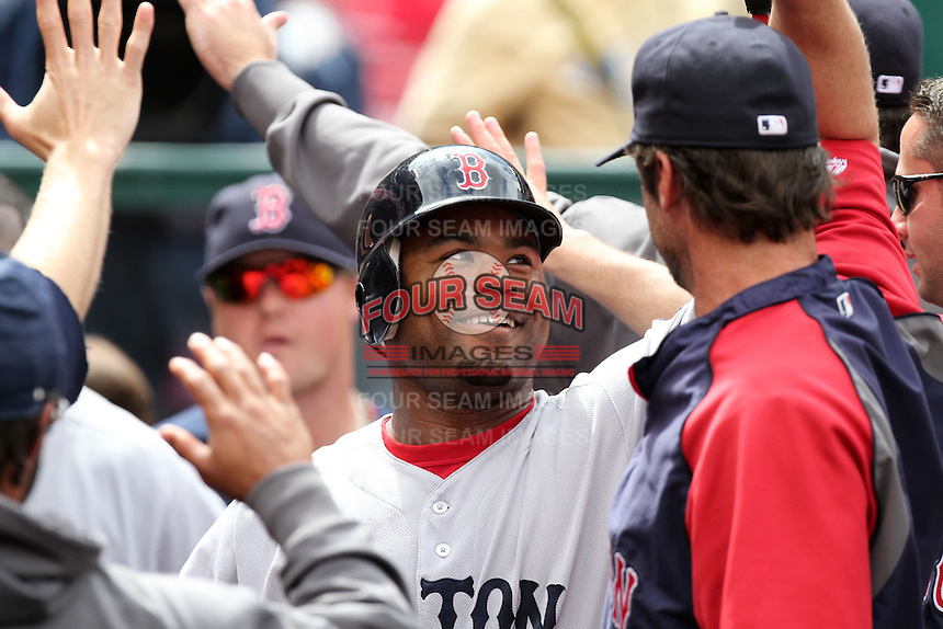 Carl Crawford #13 of the Boston Red Sox is greeted by teammates after hitting a home run against the Los Angeles Angels at Angel Stadium in Anaheim, California on April 24, 2011. Photo by Larry Goren/Four Seam Images