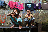 Children playing on a bench, Tallo, Makassar, Sulawesi, Indonesia.