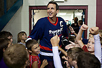 Republican presidential hopeful Tim Pawlenty is greeted by screaming children before playing in a scrimmage hockey game during a campaign stop on Friday, July 22, 2011 in Urbandale, IA.