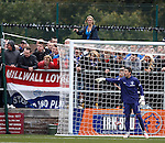 A giant Rangers fan behind Neil Alexander's goal