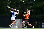 16 May 2015: Princeton's Erin McMunn (20) and Duke's Taylor Trimble (14) challenge for a faceoff. The Duke University Blue Devils hosted the Princeton University Tigers at Koskinen Stadium in Durham, North Carolina in a 2015 NCAA Division I Women's Lacrosse Tournament quarterfinal match. Duke won the game 7-3.