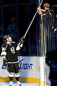 Jarret Stoll (Los Angeles Kings, #28) as a third star of the game gave hockey stick to fan after ice-hockey match between Los Angeles Kings and Phoenix Coyotes in NHL league, March 3, 2011 at Staples Center, Los Angeles, USA. (Photo By Matic Klansek Velej / Sportida.com)