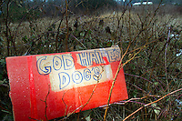 A sign sits across the street of the Olympic Animal Sanctuary in Forks, WA on December 9, 2013.  It is unclear who left it but it sat next to other signs which read: &ldquo;Reserved 4 Westboro Baptist Church.&rdquo;  According to the Southern Poverty Law Center WBC is an extremist group whose &ldquo;theology is &ldquo;Primitive Baptist,&rdquo; a doctrine that holds that God chooses a few elect humans to save, but will send everybody else to hell.&rdquo;<br /> <br />  Owner Steve Markwell Markwell has been under fire for neglecting the dogs after volunteers filed a complaint in 2012. The City of Forks police department investigated and found horrific conditions but said legally they were unable to do anything about it. Markwell claims he has 125 dogs inside and believes he is their last hope.  Many of the dogs were turned over to him by rescues and shelters who deemed them dangerous. Mounting evidence of animal cruelty has prompted many of them to ask for their dogs back.  Markwell refuses and only lets a few trusted volunteers enter the premises.