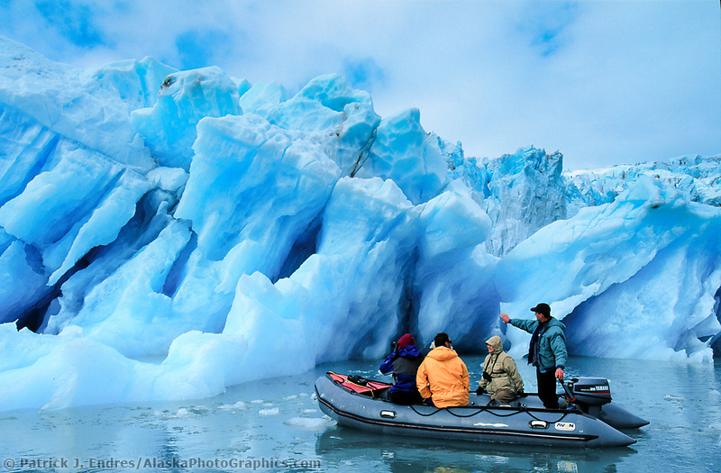 Tourists view glacier icebergs, calved off of Nellie Juan glacier, floating in Nellie Juan Lagoon, Prince William Sound, Alaska