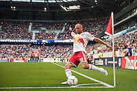 Joel Lindpere (20) of the New York Red Bulls takes a corner kick. The New York Red Bulls defeated DC United 3-2 during a Major League Soccer (MLS) match at Red Bull Arena in Harrison, NJ, on June 24, 2012.