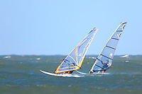Two windsurfers on the water just off of Fort Desoto Park, Tierra Verde, Florida