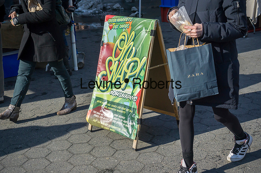 A sign in the Union Square Greenmarket in New York informs patrons that the market accepts the SNAP program and the use of EBT cards, seen on Wednesday, February 15, 2017. The paperless Electronic Benefits Transfer, which replaced food stamps, have become popular in the Greenmarkets allowing people on public assistance convenient access to fresh fruits and vegetables. (© Richard B. Levine)